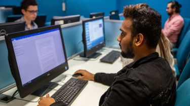 Student on computer in computer lab