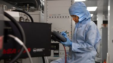 A lab technican using the MBE technique in the National Epitaxy Facility