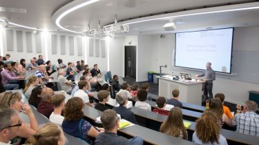 An image of a presentation to prospective students