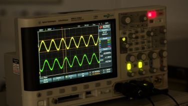 Close up of oscilloscope in use in lab