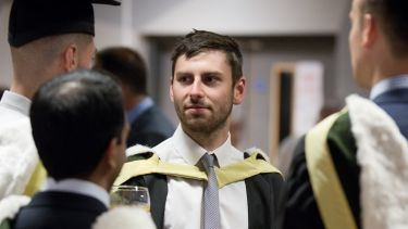An economics student at graduation - image