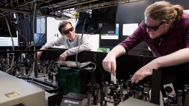 Two researchers in the Ultrafast Laser Spectroscopy Laboratory