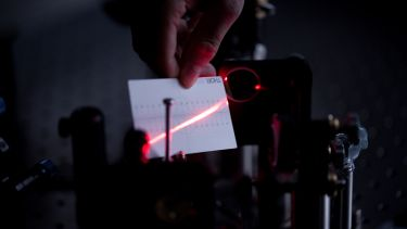 A laser shining in the Ultrafast Laser Spectroscopy Laboratory