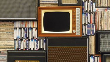 old fashioned TV, speakers, books