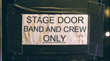sign saying stage door and and crew only
