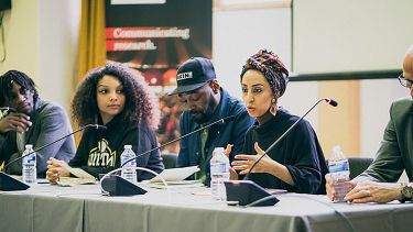 The panel at the youth symposium