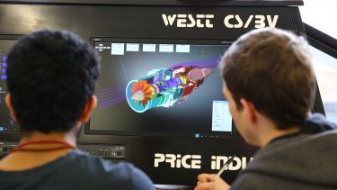 Aerospace Students studying a computer simulation of a turbine