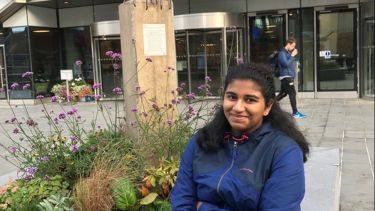 Aditi Reddy sat outside The Diamond Building