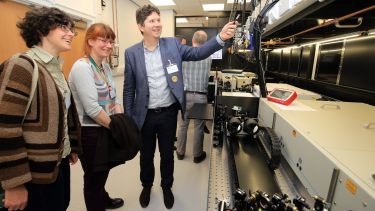 Dr Dimitri Chekulaev shows guests around the new Lord Porter Ultrafast Laser Spectroscopy Laboratory