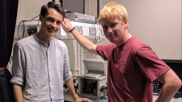 John Cully and James Baxter with the single molecule FRET microscope they built for their masters project.