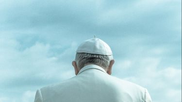 The back of the Pope's head an shoulders