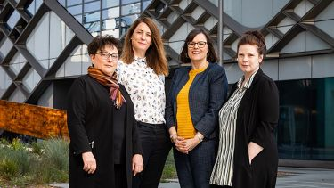 The four ladies from the Year in Industry team stand together outside The Diamond building in Sheffield.