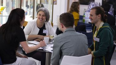 Alumni and students at a speed networking event