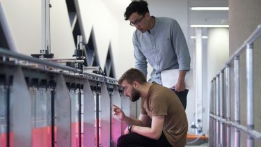 Two civil engineering students in the fluid dynamics lab