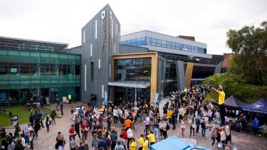 Large numbers of students gathered in front of the Students' Union for the sports fair as sporting activiting takes place.