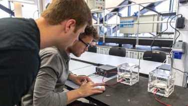 Two male students in the Diamond electronics lab