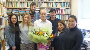 Professor Alan Walker with a group of his PhD students.