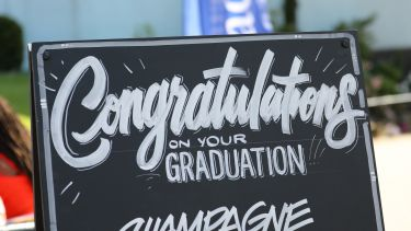 A congratulations sign outside the Student Union at graduation.