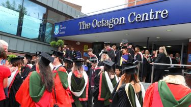 Graduates leaving The Octagon Centre after their summer graduation ceremony.