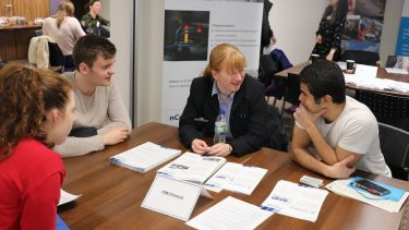 Students talking to an employer at a careers event