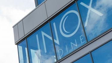 A photograph of Inox Dine taken from outside.