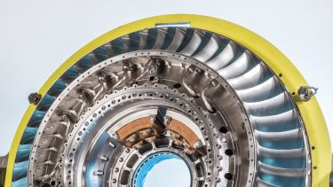 A digital image of an aircraft turbine with sections coloured in grey, yellow, blue and orange