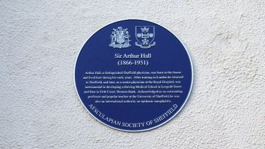 The blue plaque in recognition of Sir Arthur Hall, on the wall of 40 Victoria Street