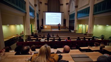 A Philosophy lecture taking place in St George's church.