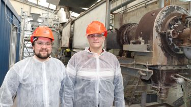 Visa Isteri (left) and Dr Theodore Hanein (right) standing next to the kiln outlet at IBU-tec Weimar.
