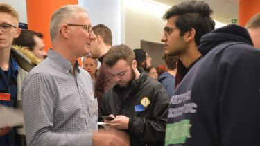 Engineering You're Hired event - students talk to employers