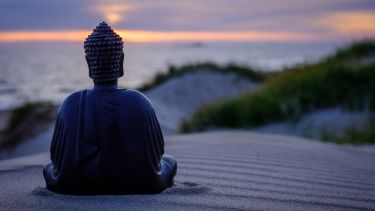 A Buddha statue on the beach
