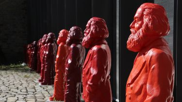 Red statues of Karl Marx