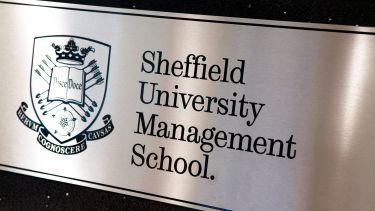 Sheffield Uiversity Management School sign, black text on a silver background