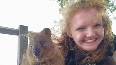 Zoe in Australia with a wallaby