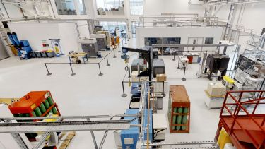 A bird's eye view of the workshop at the Royce Translational Centre, with various heavy machinery
