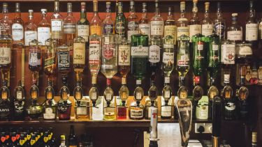 Lots of different types of alcohol in a bar in Scotland.
