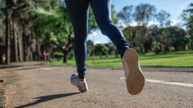 A runner's feet out jogging.