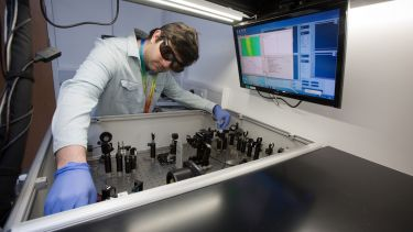 A researcher at the transient absorption station in the Ultrafast Laser Spectroscopy Laboratory