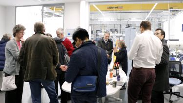 A group of people networking at the Royce Translational Centre