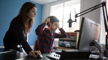 Student using recording equipment