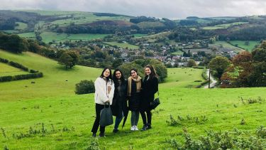 Four female international students in the countryside