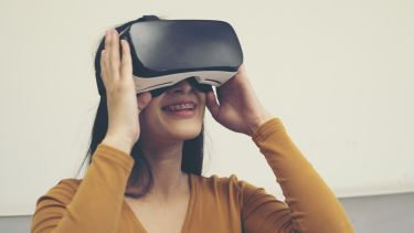 A woman uses a VR headset