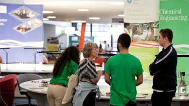 A parent in discussion with student ambassadors at an open day in The Diamond.