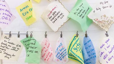 Little cards and handkerchiefs on a washing line with messages written on them for lost babies.