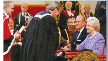 Alan Walker shaking hands with the Queen having received the Third Queen's Anniversary Prize