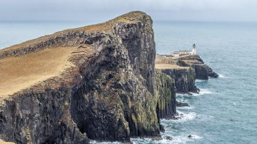 A lighthouse by the sea on a remote Scottish island.