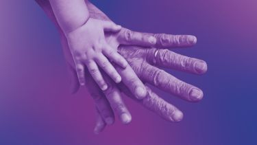 A child's hand, an adult's hand and an elderly person's hand laid on top of each other