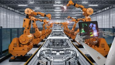 Robot arms and cars in manufacturing factory