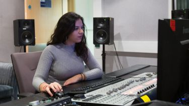 Women operating sound desk