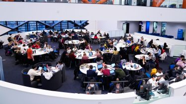 A wide shot of students sat at tables in The Diamond.